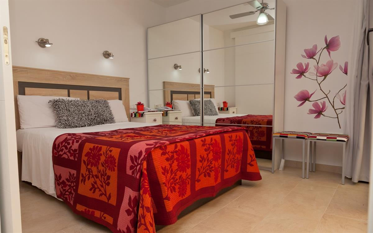 CN129 Master bedroom with modern comfortable bed and wardrobe space